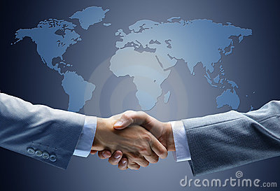 Handshake with map of the world