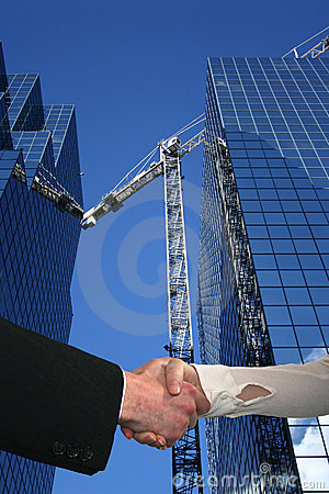 Handshake over construction site