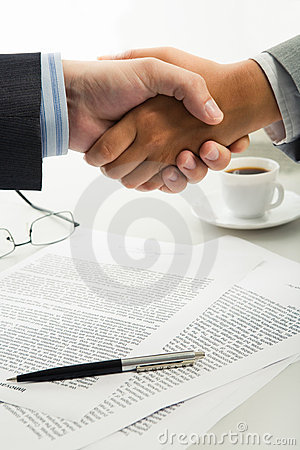 Handshake over workplace