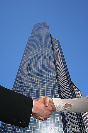 Handshake with skyscraper