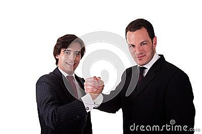 Handshake between two businessmen smilling