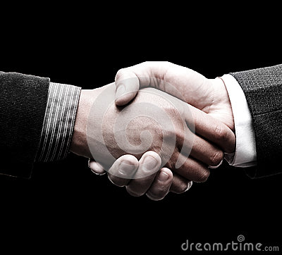 Handshake of two leaders over black background