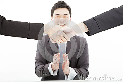 Handshaking with businessman applauding