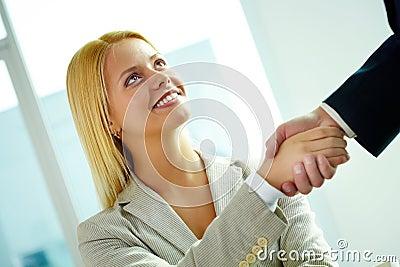 Handshaking woman