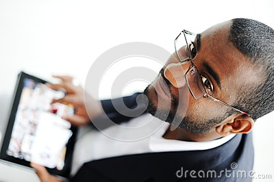 Handsome African man with tablet computer