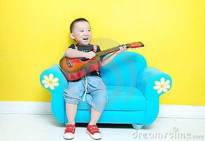 Handsome Asian  boy with guitar