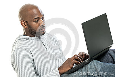 Handsome Black Man Typing on a Laptop