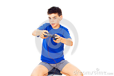 Handsome boy plays with a joystick