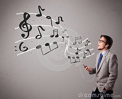Handsome boy singing and listening to music with musical notes