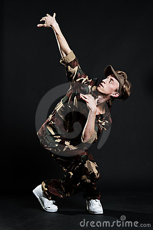 Handsome breakdancer in military uniform