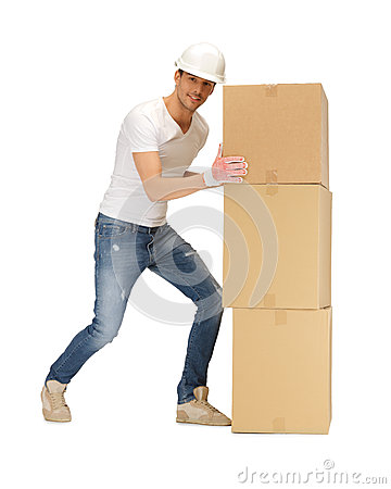 Handsome builder moving big boxes