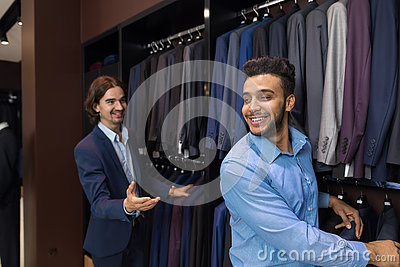 Handsome Business Man Fashion Shop, Customers Choosing Clothes In Retail Store Stock Photo