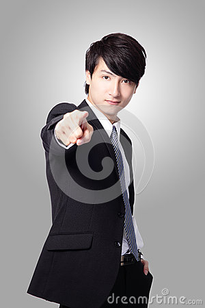 Handsome business man pointing at you