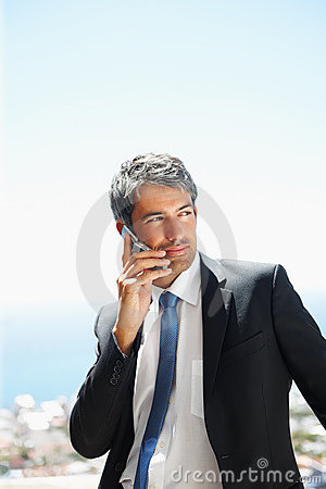 Handsome business man speaking on the mobile