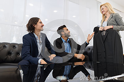 Handsome Business Man And Woman Fashion Shop, Customers Choosing Clothes In Retail Store Stock Photo
