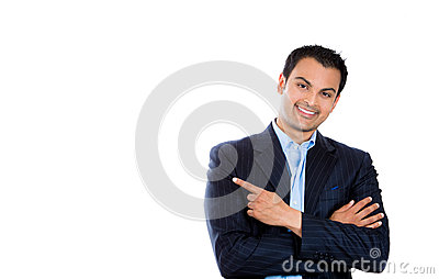 Handsome businessman or attorney or politician pointing to copy space at left