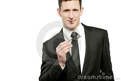 Handsome businessman in black suit on white.