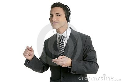 Handsome businessman dancing hearing music