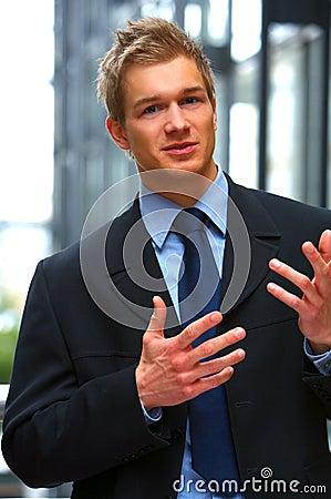 Handsome businessman explaining things