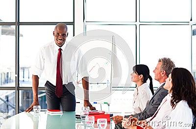 Handsome businessman after giving a presentation