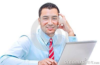 Handsome businessman with laptop. studio shot