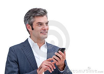 Handsome businessman looking at his phone