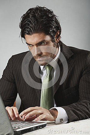 Free Handsome Businessman Looks At Portable Computer Royalty Free Stock Photo - 35331745