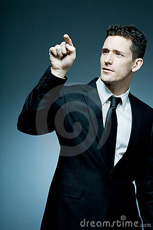 Handsome businessman making pointing gesture.