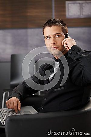 Handsome businessman on mobile