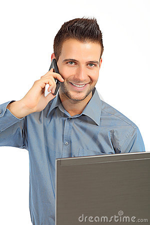 Handsome businessman with phone and notebook