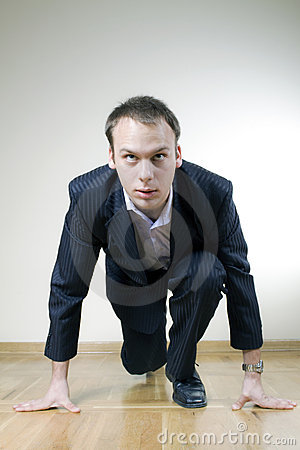 Handsome businessman ready for a race