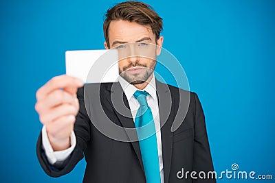 Handsome businessman showing blank business card