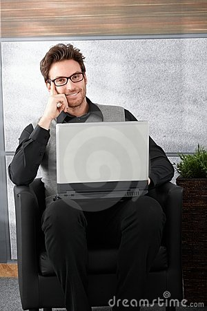 Handsome businessman smiling Stock Photo