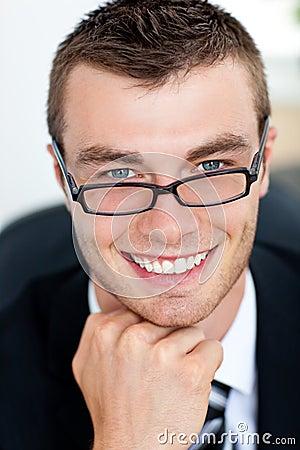Handsome businessman smiling at the camera