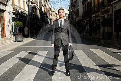 Handsome businessman standing in a crosswalk Editorial Photography
