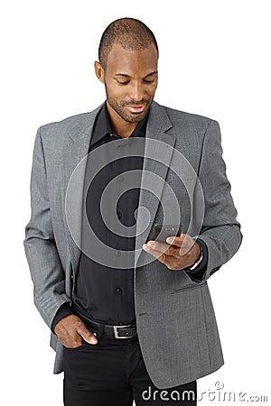 Handsome businessman texting