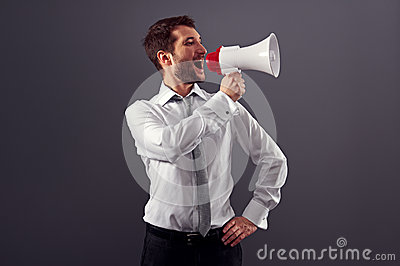 Handsome businessman using megaphone