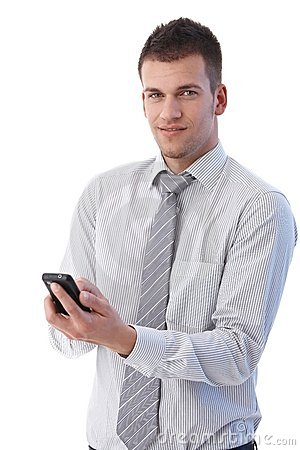 Handsome businessman using mobile phone