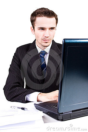 Handsome businessman at work writing on computer