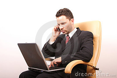 Handsome calling businessman with laptop 2