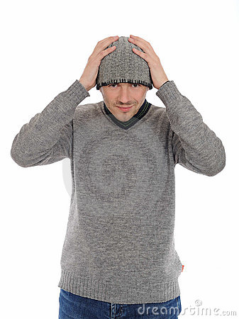 Handsome casual man in winter hat and warm clothes