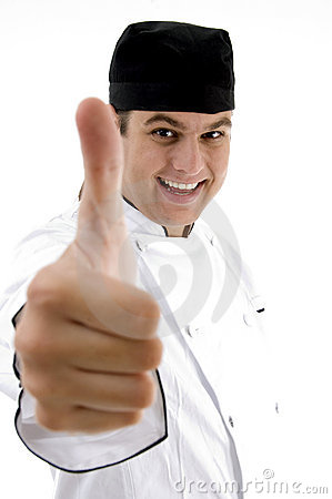 Handsome chef with okay hand gesture