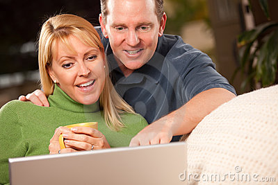 Handsome Couple Using Laptop