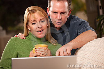 Handsome Couple Using Laptop Stock Images - Image: 13869784
