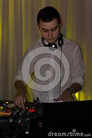 Free Handsome Disc Jockey Mixing Music Royalty Free Stock Photos - 36206178
