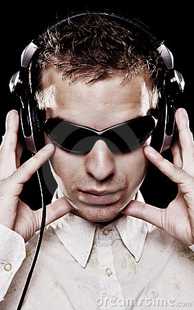 Handsome dj in sunglasses with headphones