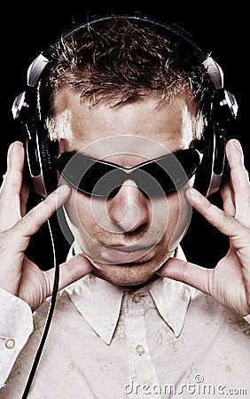 Handsome dj in sunglasses with headphones