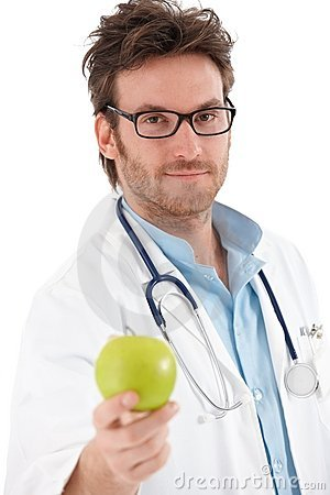 Free Handsome Doctor Holding Green Apple Stock Image - 21345241
