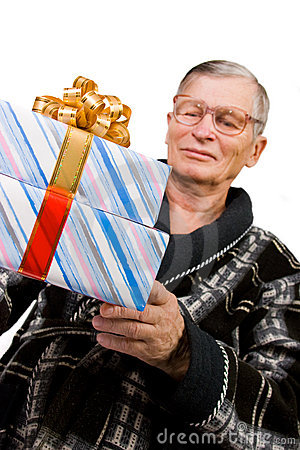 Handsome elderly man holding gift boxes