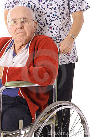 Handsome elderly man in wheelchair with nurse
